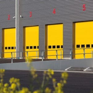 Quatre portes sectionnelles jaune Norsud