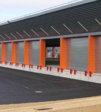 Rideaux metallique batiment orange Norsud